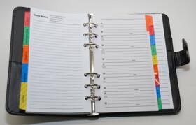 Mini Organizer mit diversen Fächern und Rubriken aus Kunstleder mit Druckknopf